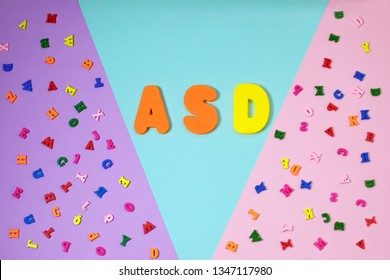 ASD. Autism spectrum disorder from color letters and color pensils on color background, World Autism Awareness Day, April Autism awareness month