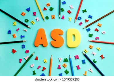 ASD. Autism spectrum disorder from color letters and color pensils on blue background. World Autism Awareness Day, April Autism awareness month