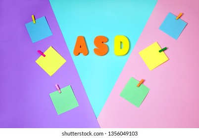 ASD. Autism spectrum disorder. Autism Concept with color paper stickers on blue background. Top view. Flat lay. Copy space.
