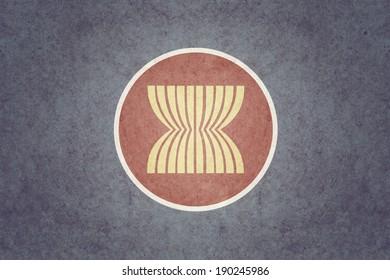 ASEAN Economic Community (AEC)  flag on old paper texture