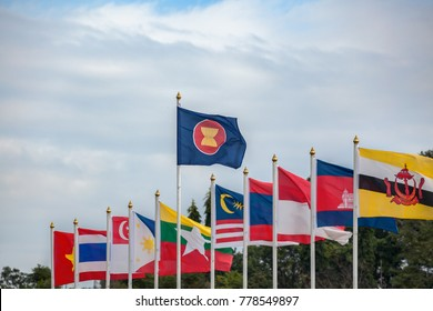 ASEAN Economic Community flags, southeast asia countries and sky background