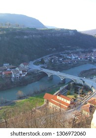 Asenovo district, Veliko Tarnovo, Bulgaria - February 2018: Panoramic view of Trapezitsa hill and Yantra valley with the arched bridge and road 514 running on it