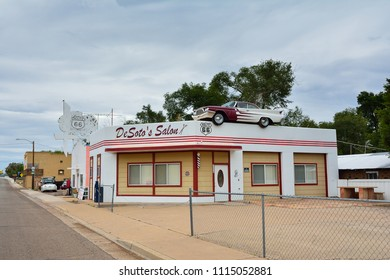 Ash Fork, Arizona - July 24, 2017: DeSoto Salon in Ash Fork, Arizona, advertised itself by placing an actual 60s era Desoto Car on its roof, with Elvis driving. The advertising appeared not to work.