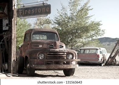 ASH FORK, USA - SEPTEMBER 25: rusty car wreck at a historic gas station at Route 66, vintage style, Ash Fork, Arizona, United States of America, sept 25 2011