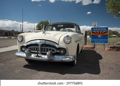 ASH FORK, USA - SEPTEMBER 25: old car wreck at a historic gas station at Route 66, vintage style, Ash Fork, Arizona, United States of America, sept 25 2011