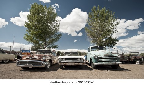 ASH FORK, USA - SEPTEMBER 25: thre old cars at the historic Route 66, vintage style, Ash Fork, Arizona, United States of America, sept 25 2011