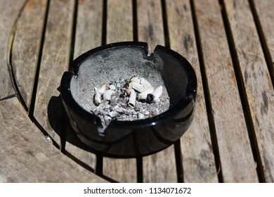 Ash tray on a wooden table