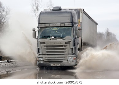 ASHA, RUSSIA - MARCH 15, 2015: Black semi-trailer truck Scania R420 at the city street during a strong flood.