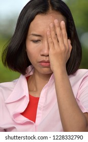 Ashamed Asian Person