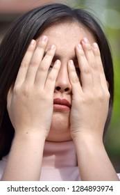 Ashamed Youthful Diverse Female
