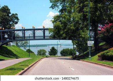Ashburn Coppock Park and South Bluffs are connected by a pedestrian bridge in downtown, Memphis, Tennessee.  Metal bridge passes over Riverfront Drive.