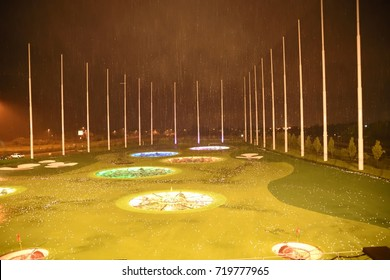 ASHBURN, VIRGINIA, USA - AUGUST 11 2017:  Top Golf golfing complex at Ashburn , heavy rain and golf complex is surrounded by golf balls in night time.