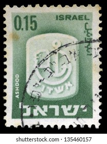 ASHDOD - CIRCA 1965: A stamp from Israel, depicting the official symbol of the city of Ashdod. Ashdod. The largest sea port of Israel resides in Ashdod. Isolated on black background. In Ashdod, Israel on Circa 1965.