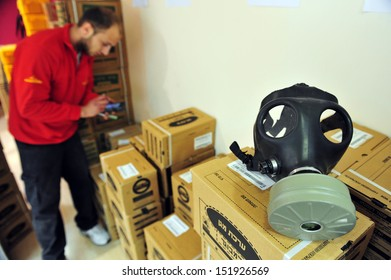 ASHDOD, ISRAEL - APRIL 6: Gas masks distribution worker on April 06 2010.Reports of a possible American attack in Syria have caused a sharp rise in the number of Israelis seeking gas masks.