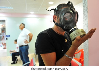 ASHDOD, ISRAEL - APRIL 6: Israeli man testing gas mask on April 06 2010.Reports of a possible American attack in Syria have caused a sharp rise in the number of Israelis seeking gas masks.