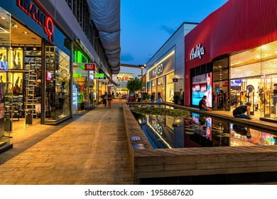 ASHDOD, ISRAEL - JULY 18, 2019: Shops and retail stores in open air mall at evening - owned by BIG Shopping Centers Ltd., founded in 1994, operates in four countries - Israel, USA, India and Serbia.