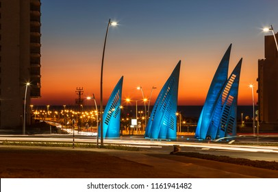 ASHDOD, ISRAEL - NOVEMBER 07, 2016: Sculptural group sails with changing colors at sunset in Ashdod, Israel
