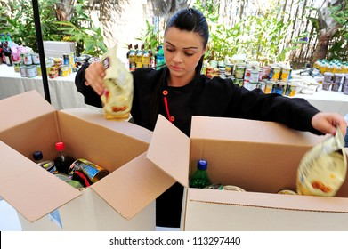 ASHDOD-APRIL 14:An Israeli woman prepares packages of food to give to the poor for the Jewish holiday of Passover in Ashdod, Israel on April 14, 2011.It commemorates the story of the Exodus in Egypt.