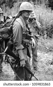 Ashdown Forest Kent UK 2001. An unidentified reenactor of the Vietnam War wears the period uniform of a US Rifleman he stands M16 rifle in hand at a re-enactment of a Battle of Dewey Canyon 1968.