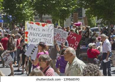 ASHEVILLE - MAY 25: A crowd on GMO and Monsanto protesters with signs at a rally in Pack Square in Asheville, North Carolina, USA, on May 25, 2013