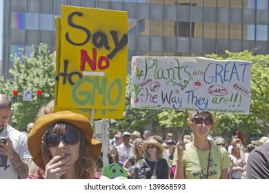 ASHEVILLE - MAY 25: Protesters protesting genetically modified foods holding signs at a rally in downtown Asheville, North Carolina, on May 25, 2013
