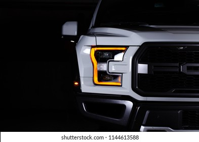 Asheville, NC - July 2018: Ford F150 Raptor isolated by light with black background