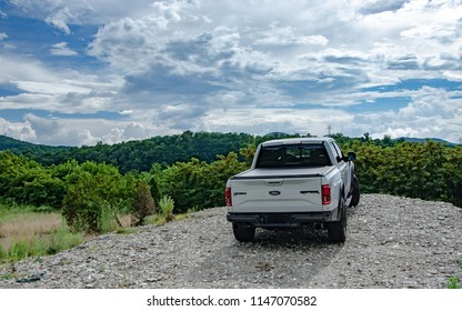 Asheville, NC - July 2018: Ford F150 Raptor parked on gravel facing mountains and sky