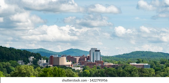 Asheville, NC / USA - May 10, 2019: This is a panoramic view of the Mission Hospital in Asheville, NC. Located in Buncombe County. It shows the campus as well as the mountains in the background.