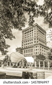 Asheville, NC / USA - May 11, 2019: Sepia toned  photo of the Buncombe County courthouse in Asheville, NC on a beautiful spring day with blue skies and white clouds.