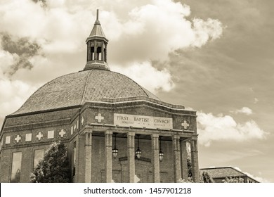 Asheville, NC / USA - May 11, 2019: Sepia toned photo of the First Baptist Church in Asheville, NC on a beautiful spring day showing passing clouds on a blue sky.