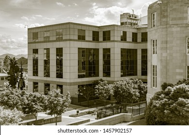 Asheville, NC / USA - May 11, 2019: Sepia toned photo of the Veach-Baley Federal Complex in Asheville, NC. Shows the building with all the glass windows and trees in the courtyard.