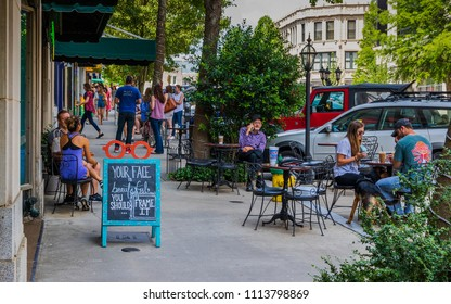 ASHEVILLE, NC, USA-10 JUNE 18:  Dining and socializing on a sunny Sunday on Battery Park Ave.