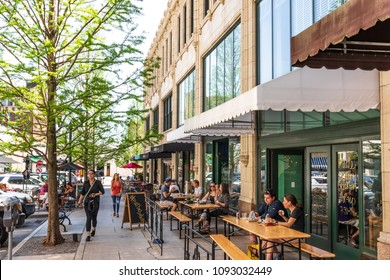 ASHEVILLE, NC, USA-13 MAY 2018:Diners relaxing on Page Ave. in downtown Asheville, NC, USA on a warm, sunny spring day.