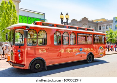 ASHEVILLE, NC, USA-13 MAY  2018:The Gray Line nostalgic trolley tours in Asheville, NC, USA highlight the history, homes and hot-spots of the town.