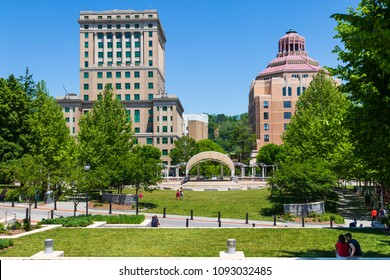 ASHEVILLE, NC, USA-13 MAY 2018:The  17-story Buncombe County courthouse (left) and Asheville, North Carolina, USA, art deco City Hall, set at the edge of Pack Square along with an amphitheater and park.