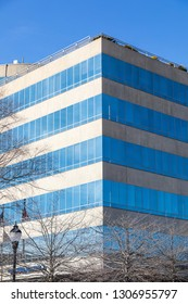 ASHEVILLE, NC, USA-2/3/19: The front corner of concrete and glass Biltmore Corporate Center building in Pack Square.