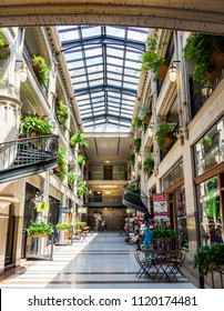 ASHEVILLE, NC, USA-24 JUNE 18: A hallway inside the Grove Arcade, featuring a variety of small shops.