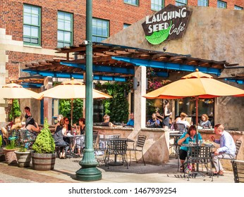 ASHEVILLE, NC, USA-27 JULY 2019:  The Laughing Seed Cafe, on Wall St. in downtown Asheville, is busy with customers in the open air environment.