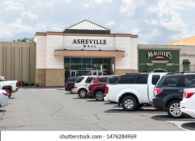 ASHEVILLE, NC,, USA-27 JULY 2019:  The main front entrance to the Asheville Mall, showing parking lot and cars.