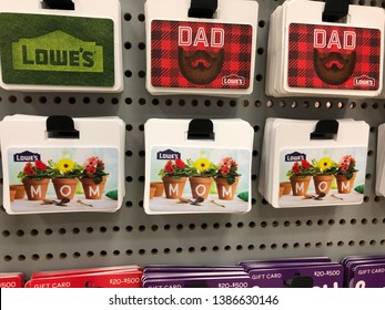 Asheville, NC/USA - 5-1-2019: This is a photograph of gift cards for both Mother's Day and Father's Day available at the store Lowe's. Gift cards are used in different denominations as gifts.