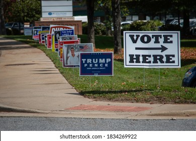 Asheville, North Carolina - 15 October 2020: A Trump/Pence sign leads the way into the long lines of early voters in North Carolina