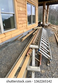 ASHEVILLE, North Carolina - APRIL 7, 2019. New home construction is strong in Western North Carolina. This home shows the log home construction with stairs, deck and mountain view.