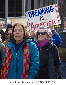 "ASHEVILLE, NORTH CAROLINA - JANUARY 20, 2018: Women marching in the 2018 Women's March carry a sign saying ""Dreaming Is America"" in downtown Asheville, NC, USA"