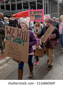 ASHEVILLE, NORTH CAROLINA - JANUARY 20, 2018: People in the 2018 Women's March carry signs promoting DACA (USA Deferred Action for Childhood Arrivals) or Dream Act saying immigrants make America great