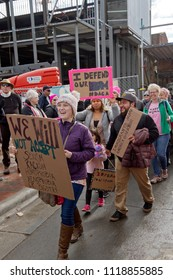 ASHEVILLE, NORTH CAROLINA - JANUARY 20, 2018: People in the 2018 Women's March carry signs promoting DACA (USA Deferred Action for Childhood Arrivals) or Dream Act legislation saying immigrants make A