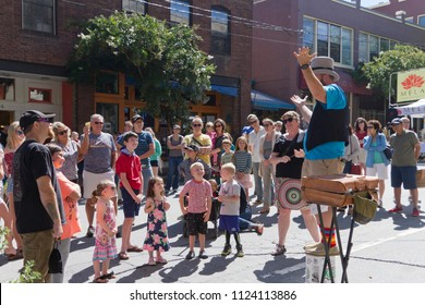 ASHEVILLE, NORTH CAROLINA -  SEPTEMBER 3, 2017: A street magician entertains a crowd during the LAAF Festival in downtown Asheville, North Carolina around the end of summer
