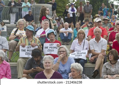 "Asheville, North Carolina, USA - August 4, 2014:  An unhappy crowd of citizens holds political signs that says ""Let the People Vote"" at the 2014 Moral Monday rally on August 4, 2014 in Asheville, NC"