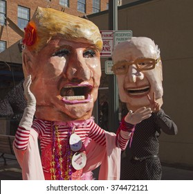 Asheville, North Carolina, USA - February 7, 2016: Close up of colorful, larger than life presidential candidate characters Donald Trump and Bernie Sanders giving the peace symbol during Mardi Gras