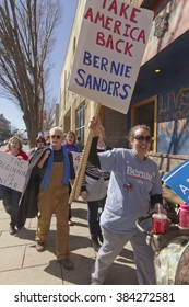 Asheville, North Carolina, USA - February 28, 2016:  Enthusiastic Bernie Sanders rally supporters who want to take America back and start anew march holding signs in downtown Asheville, NC