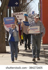 Asheville, North Carolina, USA - February 28, 2016:  A crowd of Bernie Sanders rally supporters march holding a variety of signs in downtown Asheville, NC